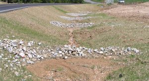 Poor channel restoration with rock check dams