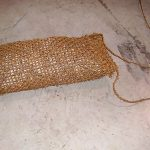 Coir rock bag with rocks for sediment control .